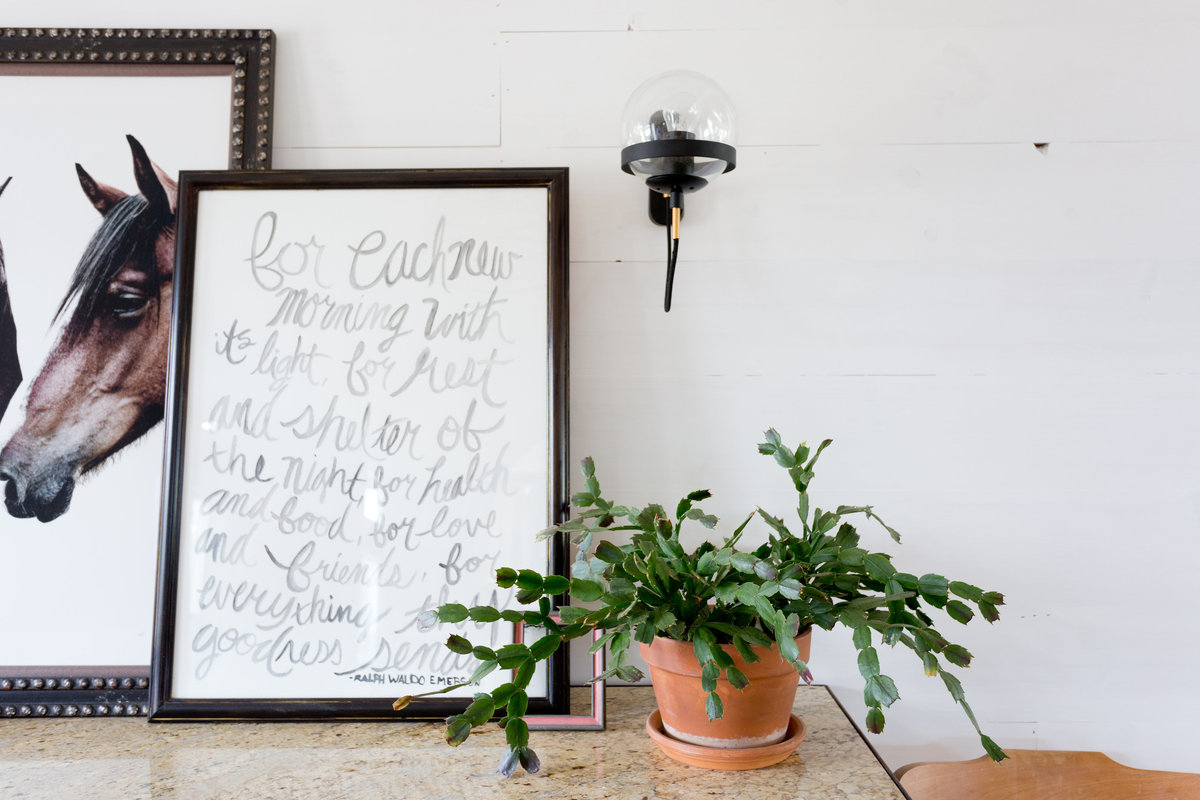 Entry table with Ralph Waldo Emerson quote, Kara Rosenlund horse print, christmas cactus,  shiplap wall, and modern sconce