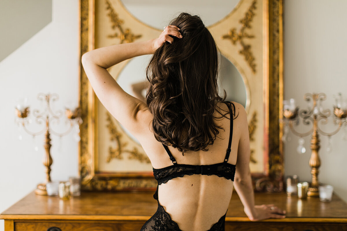 A boudoir pose taken from behind
