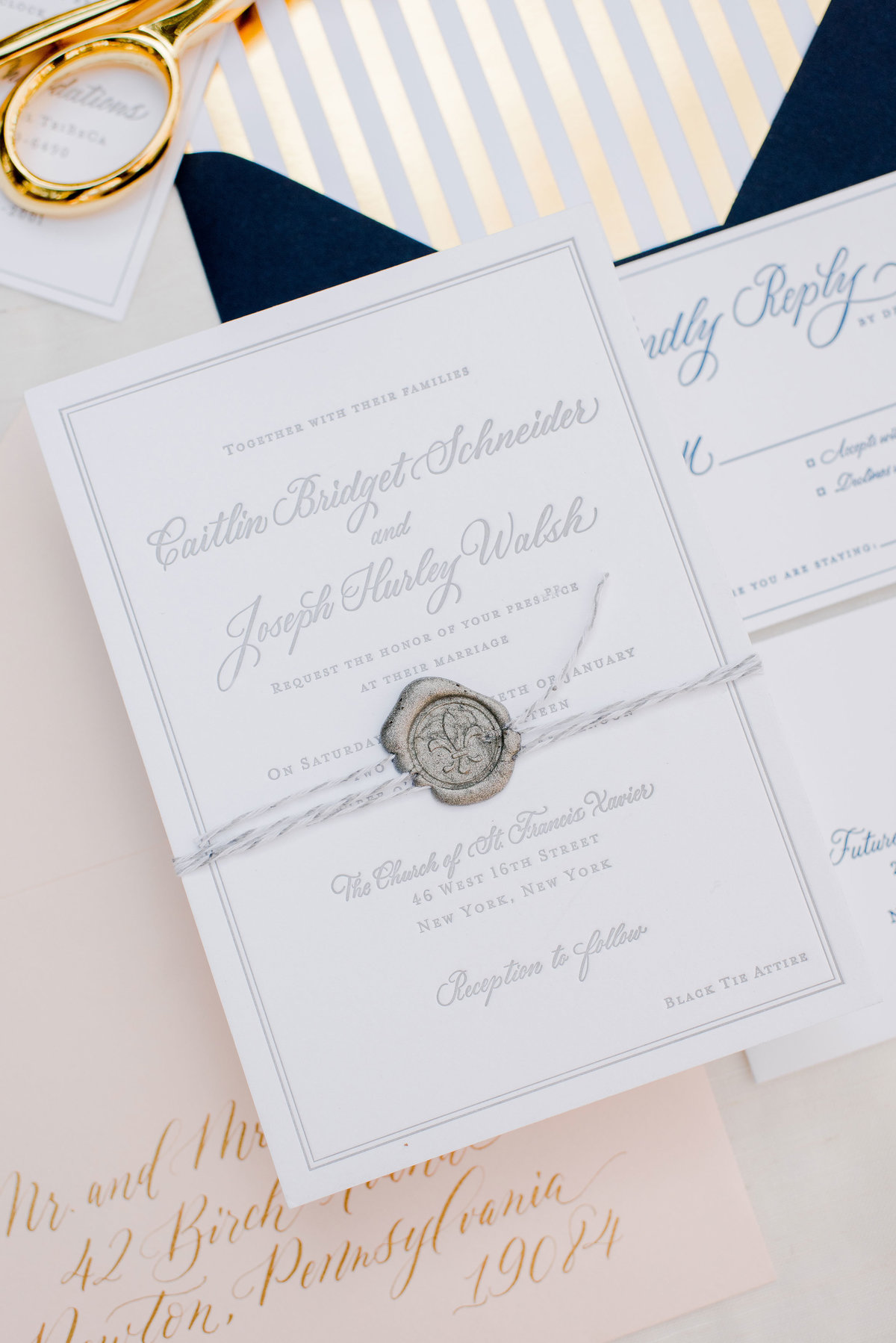 Gray ink details of wedding invitation suite