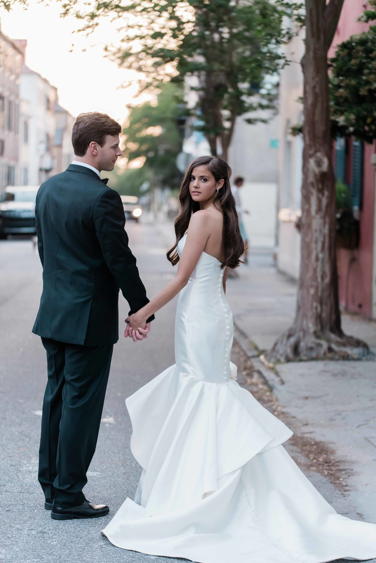 Bride and groom portraits around downtown Charleston, SC at sunset