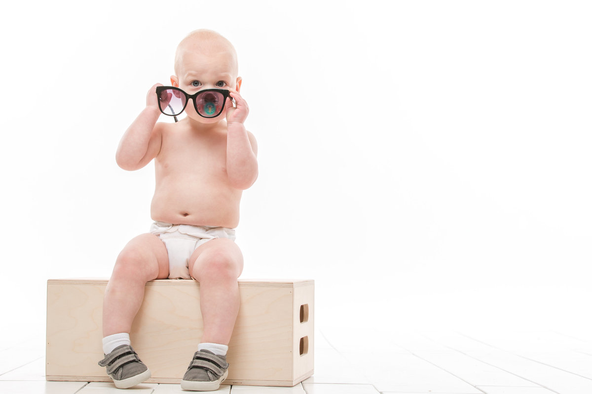 seattle portrait photographer baby with sunglasses studio image