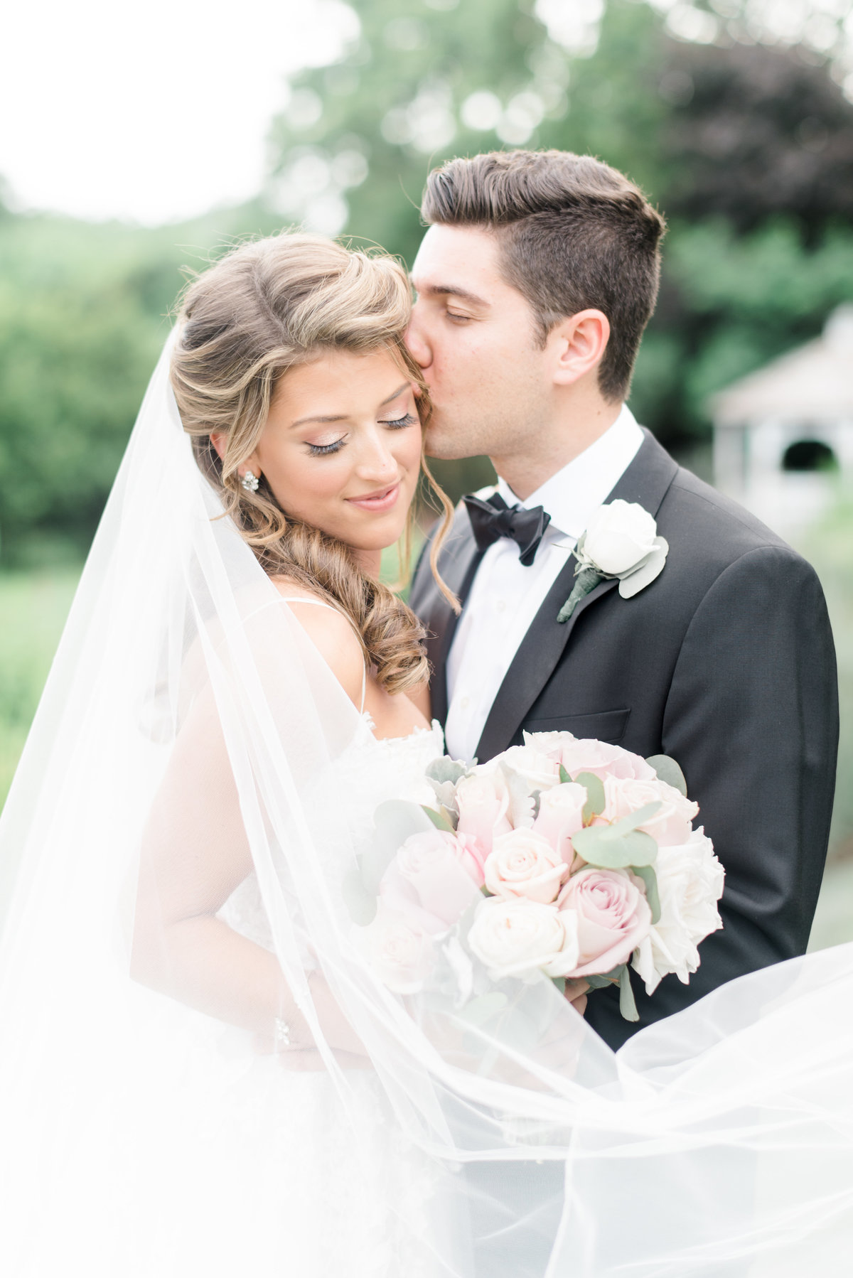 First-look-photography-groom-kissing-bride-candid-happy-bride
