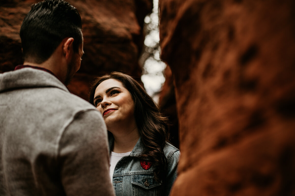 woman looking at fiancé in canyon