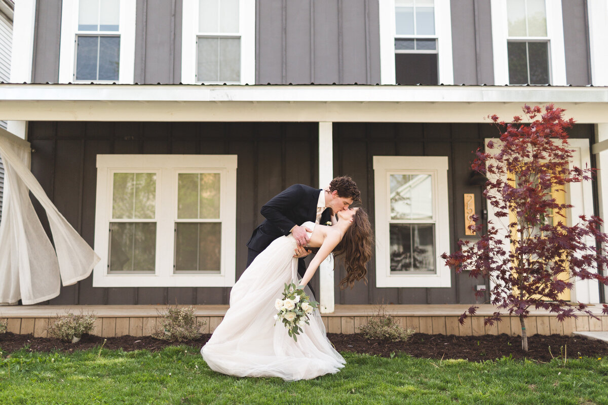 micro-wedding-at-home-intimate-ceremony-bride-groom-dip-kiss-ohio