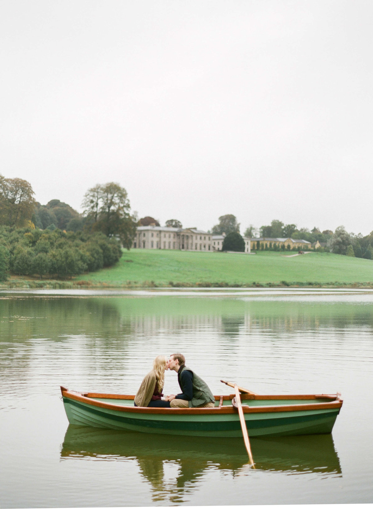 6-KTMerry-destination-weddings-Ireland-Ballyfin-couple-boating