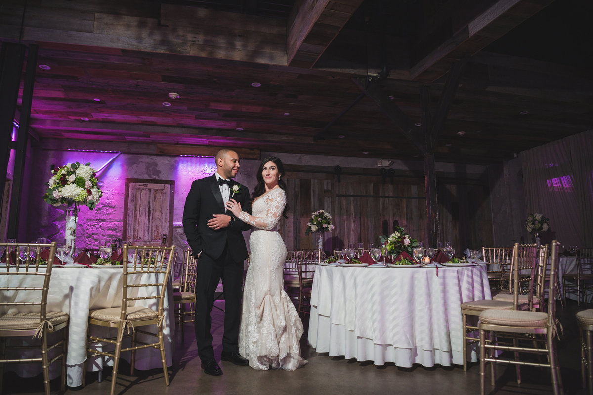 photo of bride and groom posing in wedding reception hall at The Loft by Bridgeview