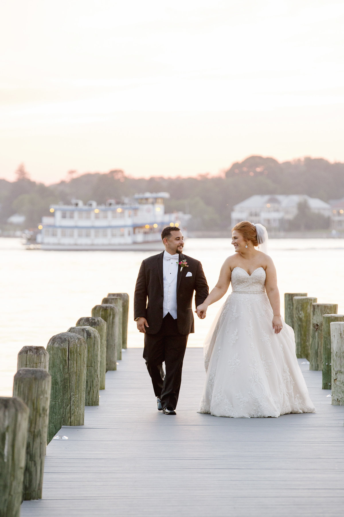 bride and groom on dock at clarks landing yacht club wedding