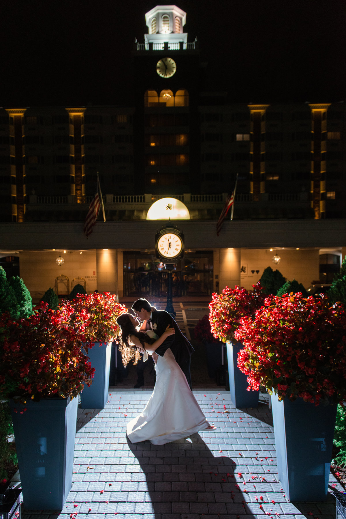night shot of bride and groom outdoors during wedding at The Garden City Hotel