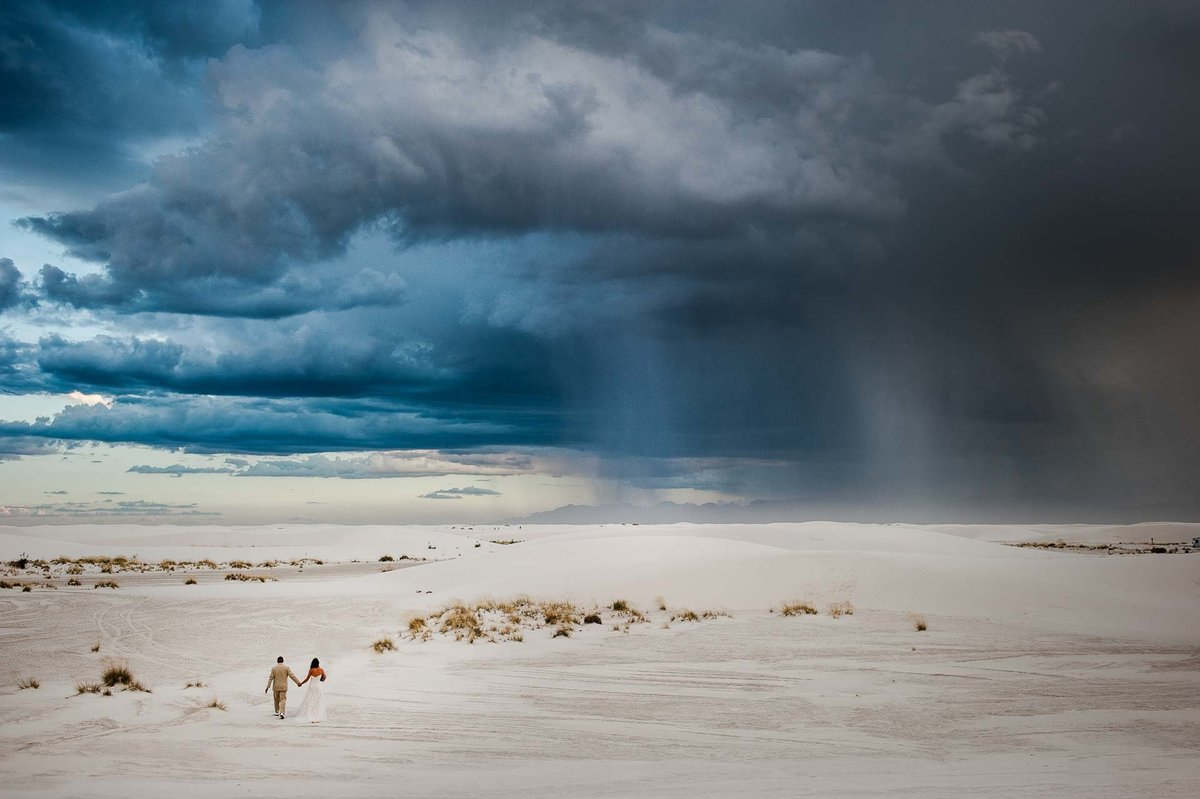 couple walking at white sands