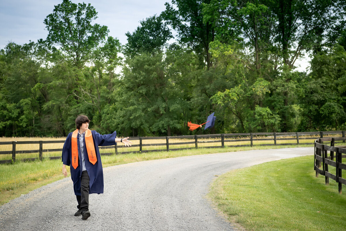 senior photos cap and gown hat toss