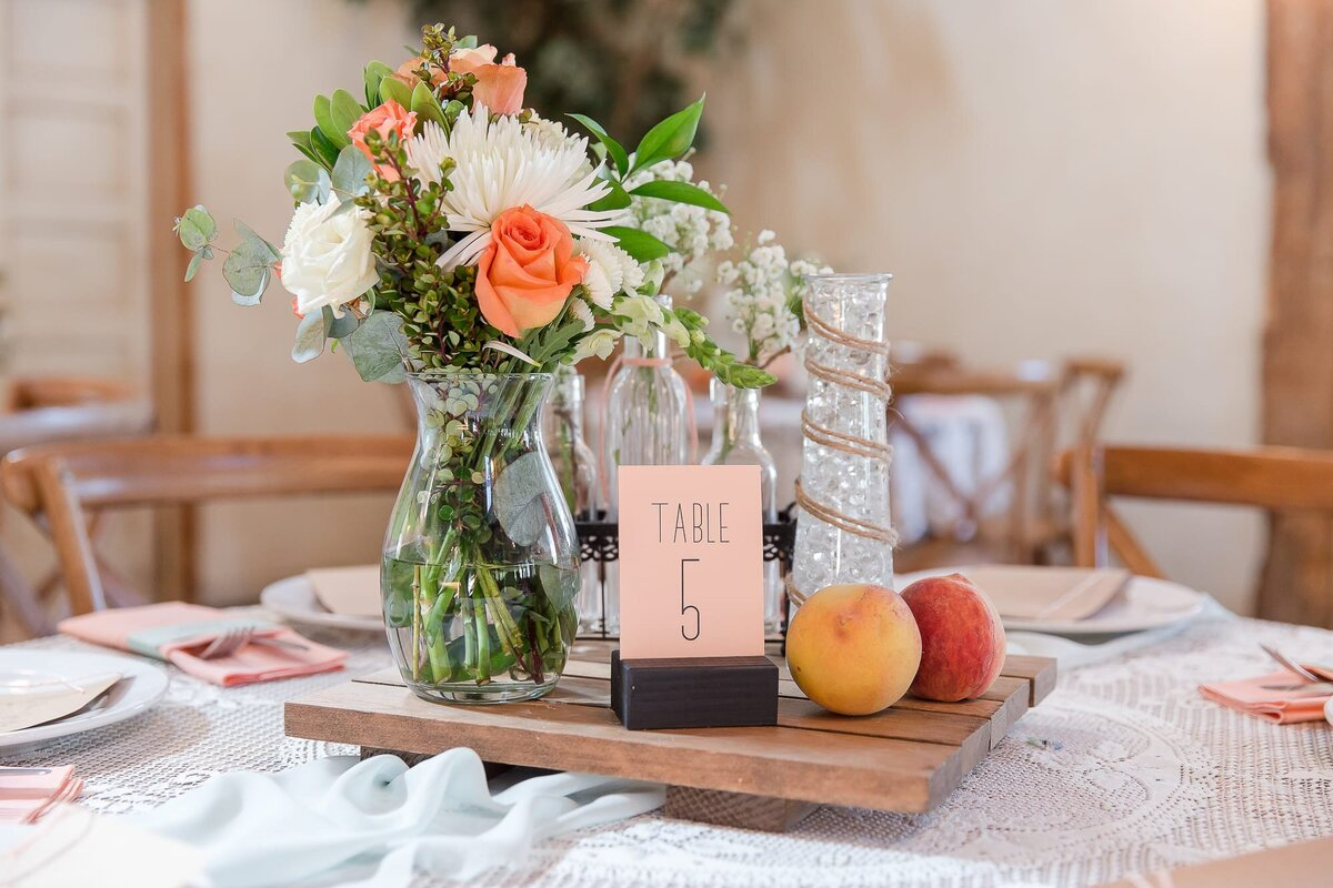 wedding-reception-centerpiece-with-fruit-and-flowers