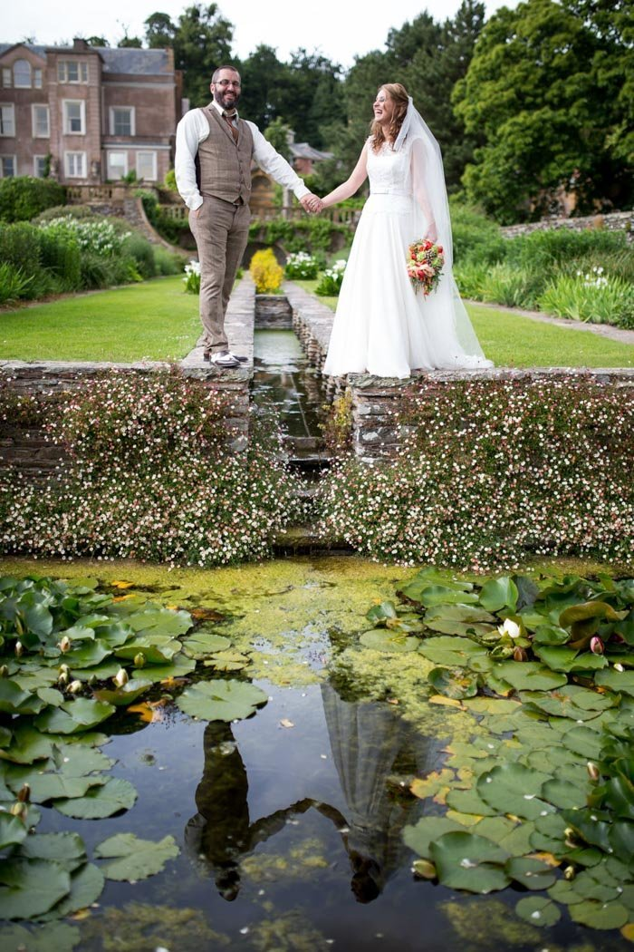 Bride & Groom reflected in the Rill at Hestercombe Gardens Somerset