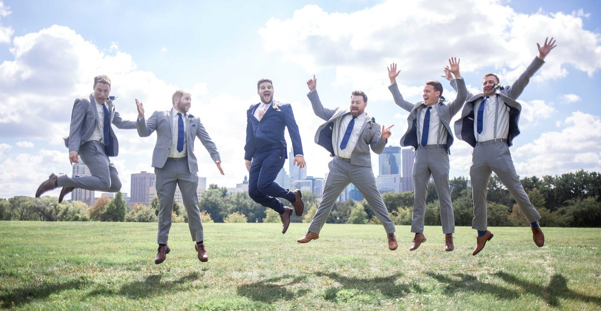 Groom with his groomsmen jumping