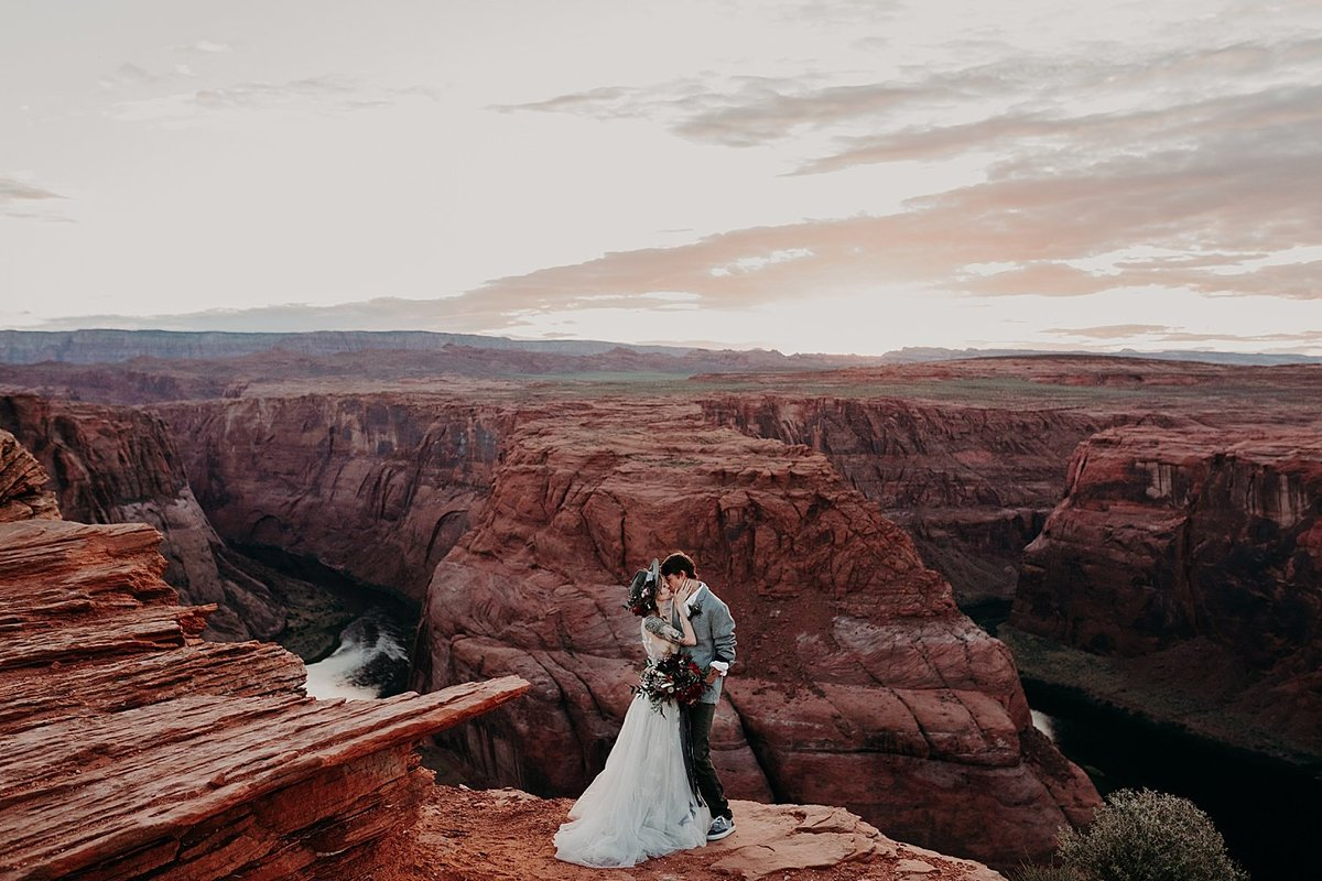 Bride and Groom face one another and kiss at Horseshoe bend