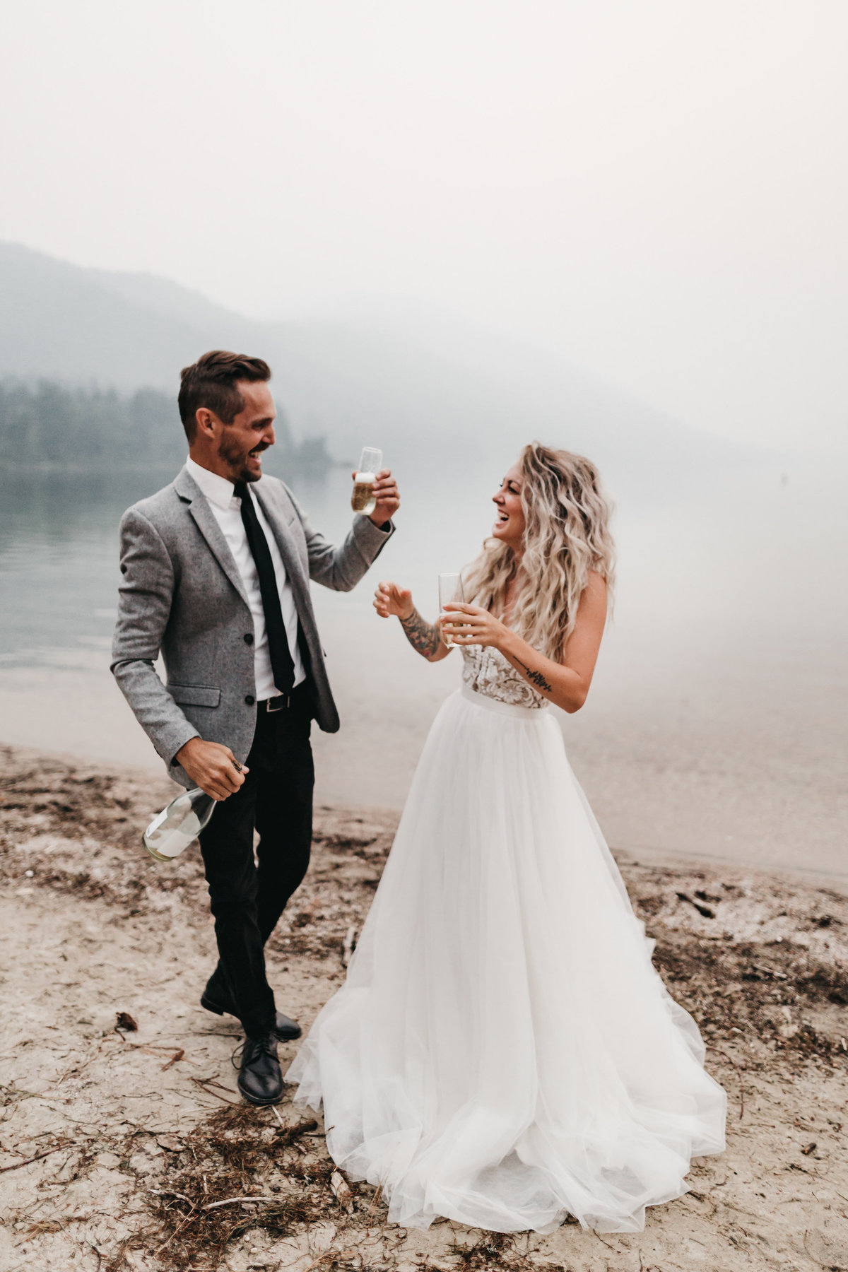 athena-and-camron-sara-truvelle-bridal-wenatchee-elopement-intimate-46-champagne-pop-bride-groom-fun-cheers