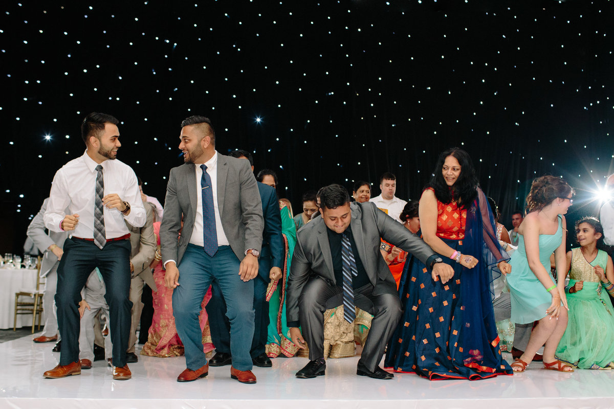 Indian dancing by destination wedding photographer Rebecca Cerasani