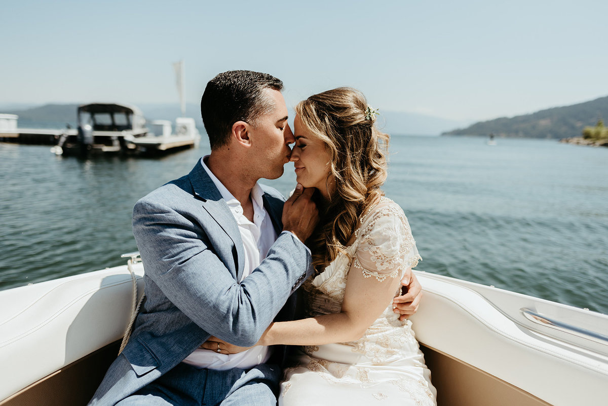 Bride & Groom kissing on boat in Coeur d'Alene, Idaho