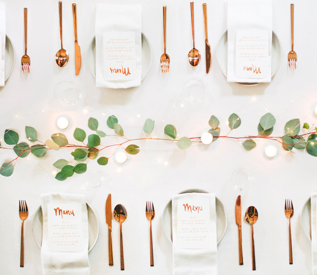 simple white copper and eucalyptus weddign table setting