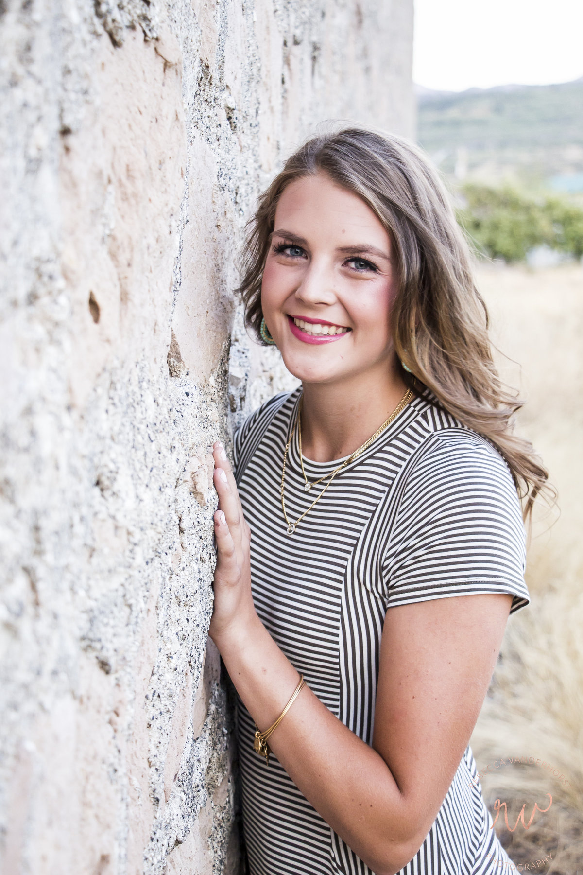 Stone wall, senior photos, high school female