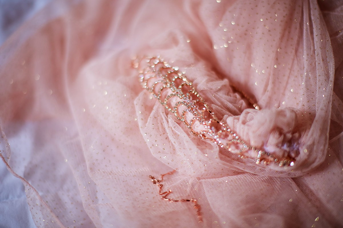 Bride's rose gold and blush veil, cape, and jewelry