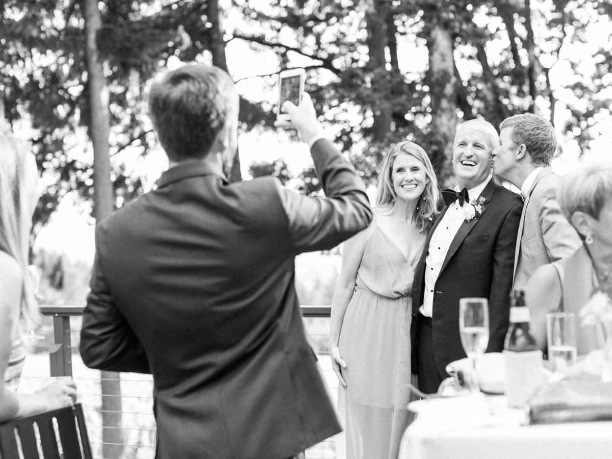 guests taking photos during cocktail hour