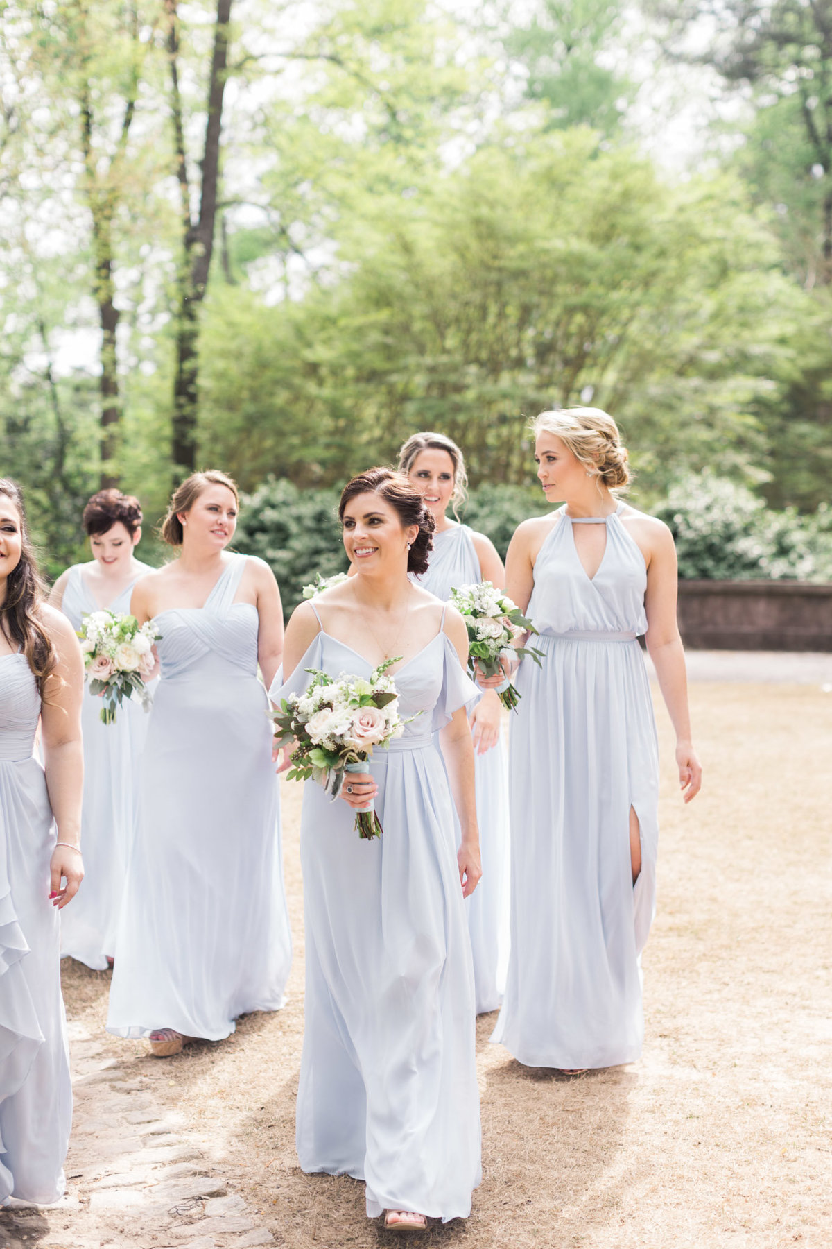 These bridesmaids dresses flowed so beautifully as they walked through the Swan House gardens. Photo by luxury destination wedding photographer Rebecca Cerasani.