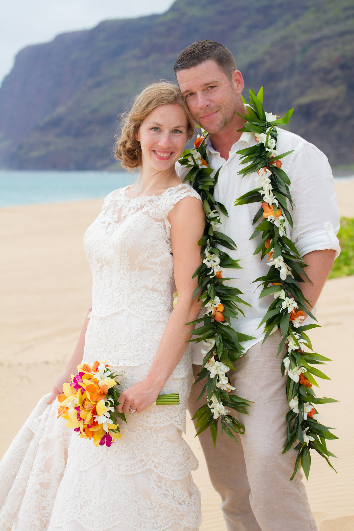 Wedding photos on the beach in Kauai, Hawaii.