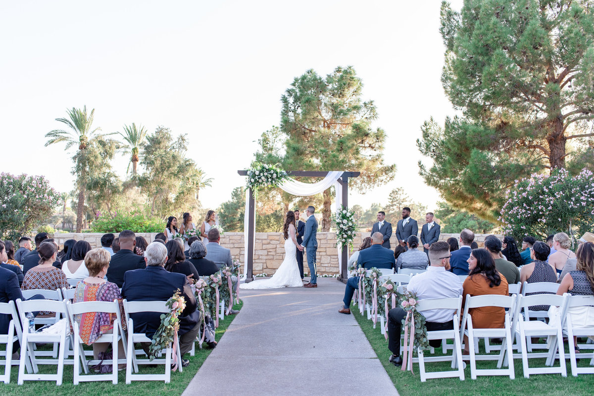 bride and groom get married at wedgewood weddings at ocotillo