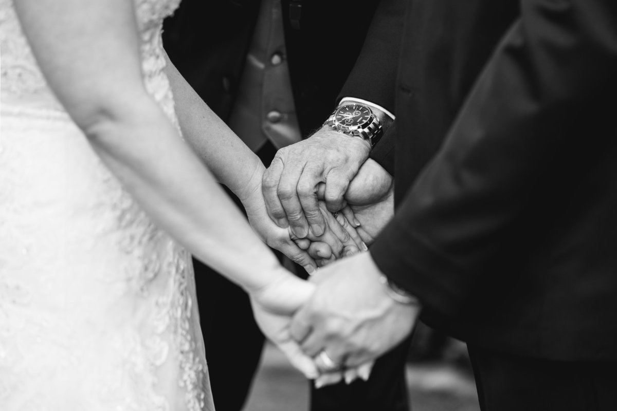 terrace club wedding photographer holding hands prayer ceremony 2600 US-290, Dripping Springs, TX 78620