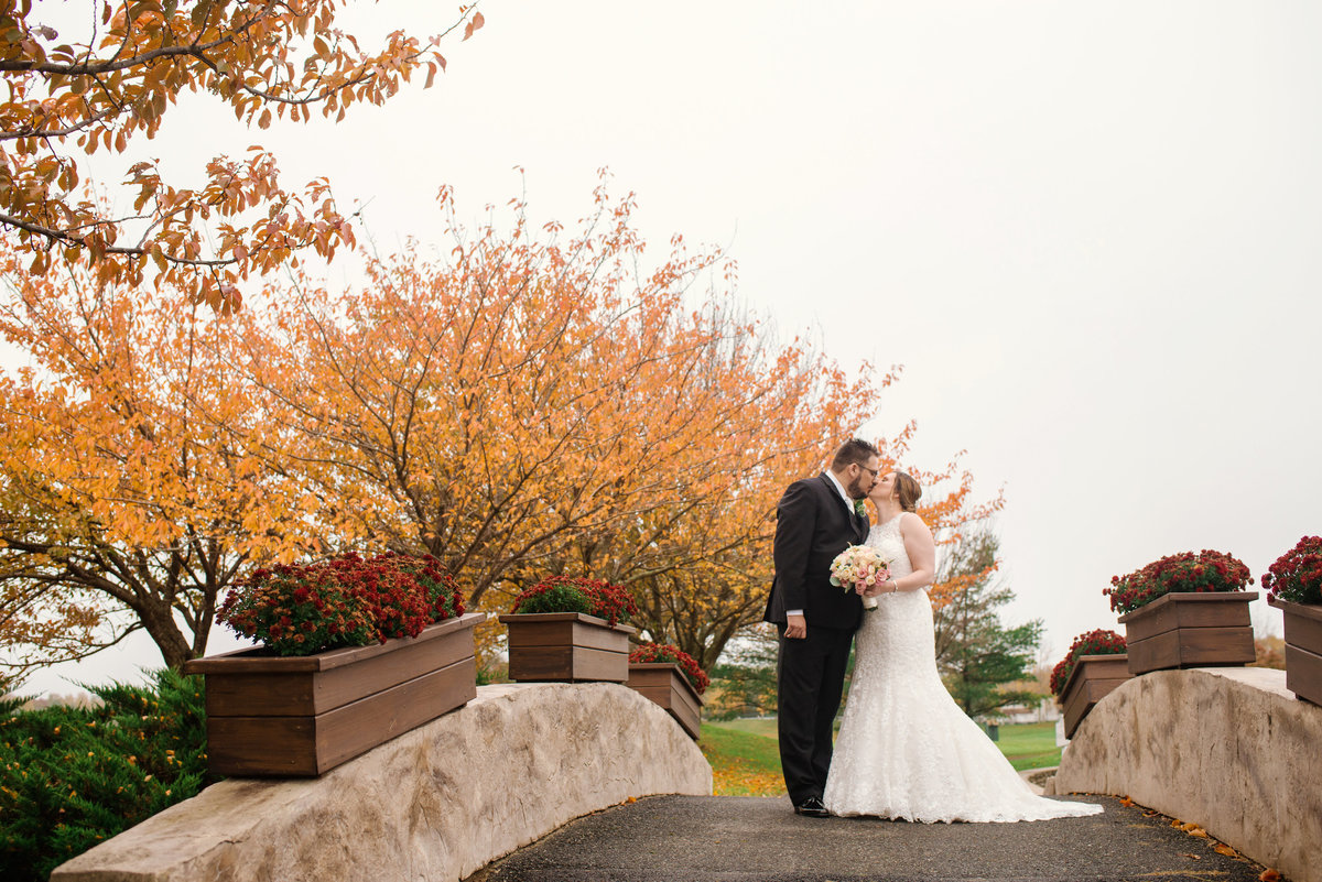 fall wedding photo of bride and groom outside at Willow Creek Golf and Country Club