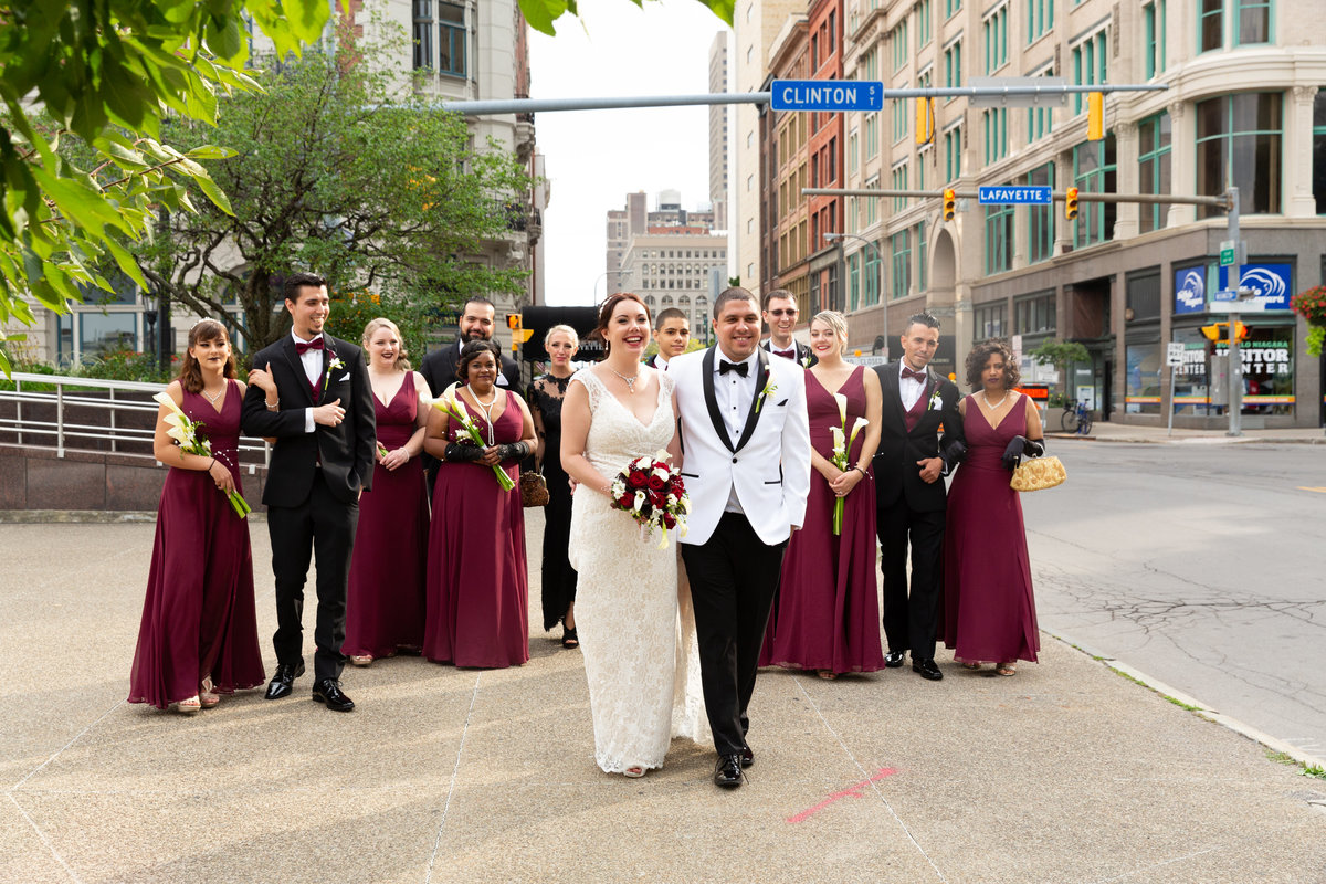 bride and groom with their wedding party  in downtown Buffalo NY