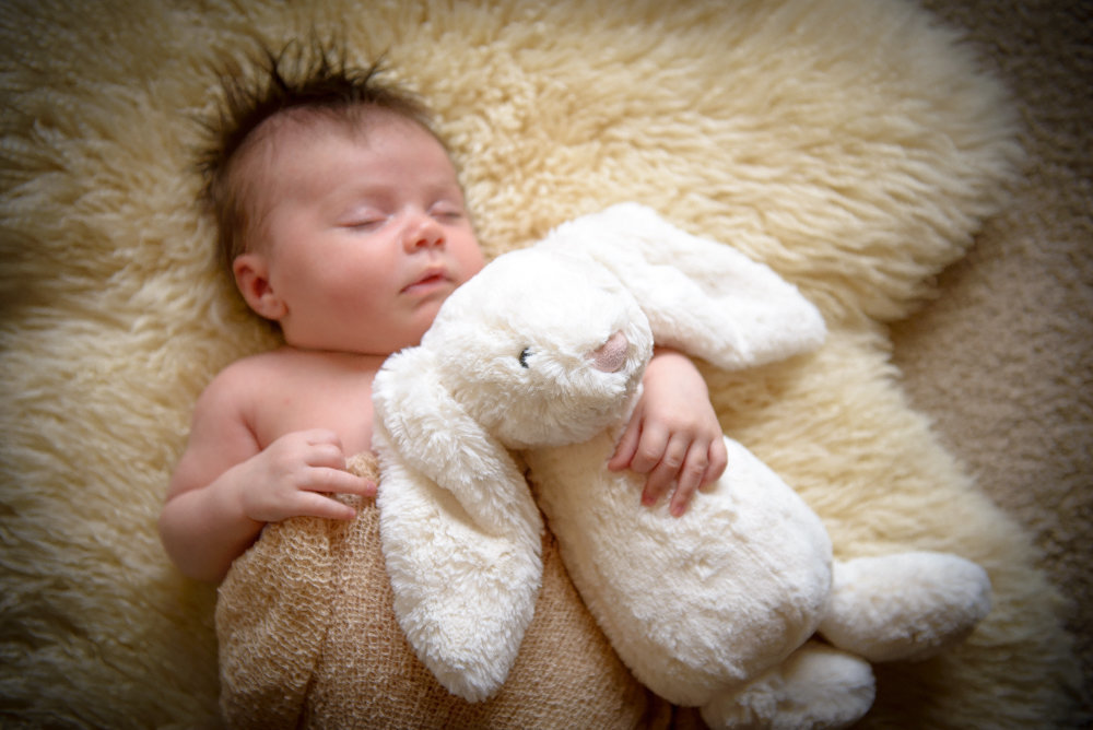 Baby girl with stuffed bunny