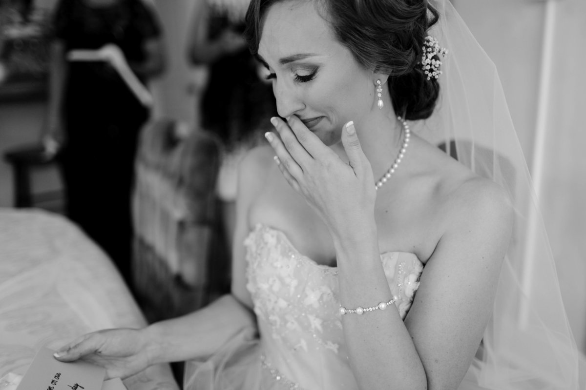 bride crying reading grooms letter