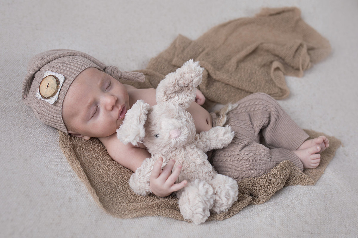 newborn boy with stuffed rabbit