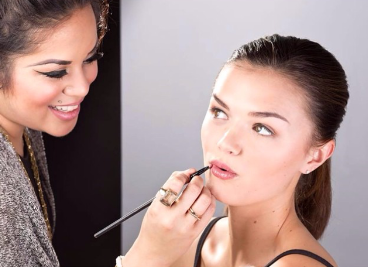 Lyndsey Ariel applies makeup for a client during a headshot session in NYC.