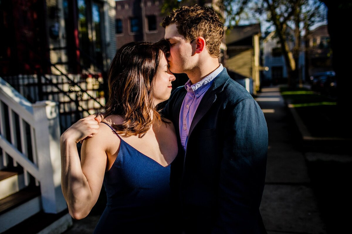 A couple hugs during a Roscoe Village engagement session.