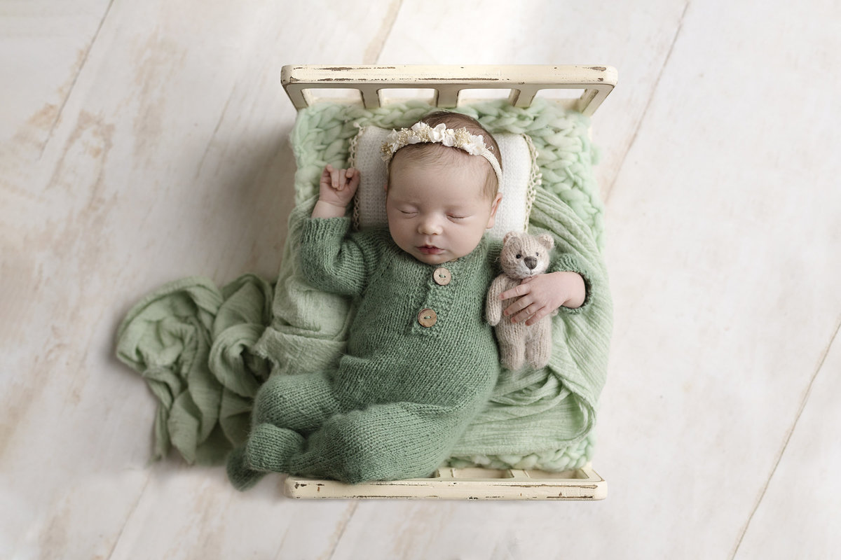 columbus ohio newborn photographer baby girl on cozy bed prop in mint and cream