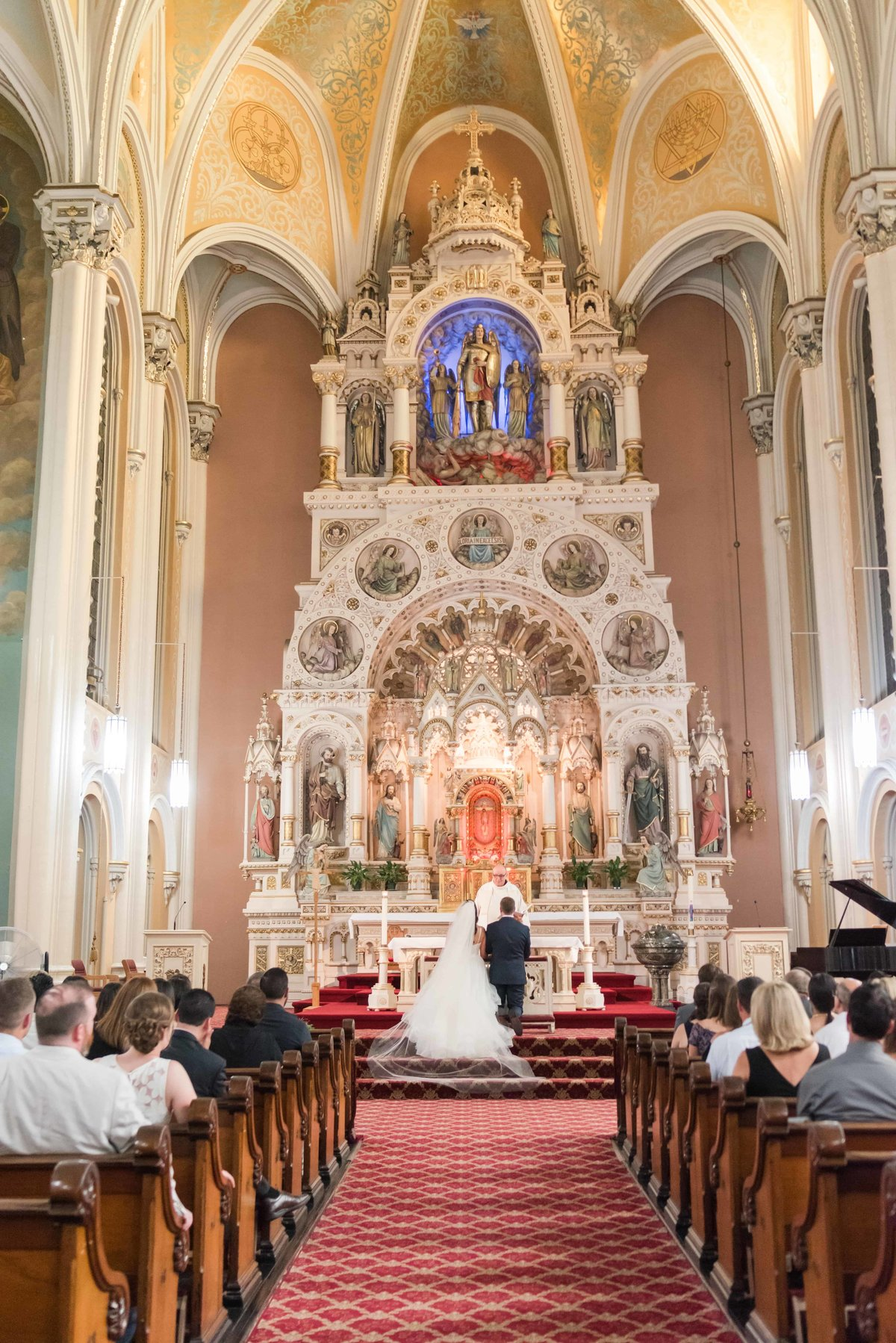 Bride and groom getting married in a catholic church