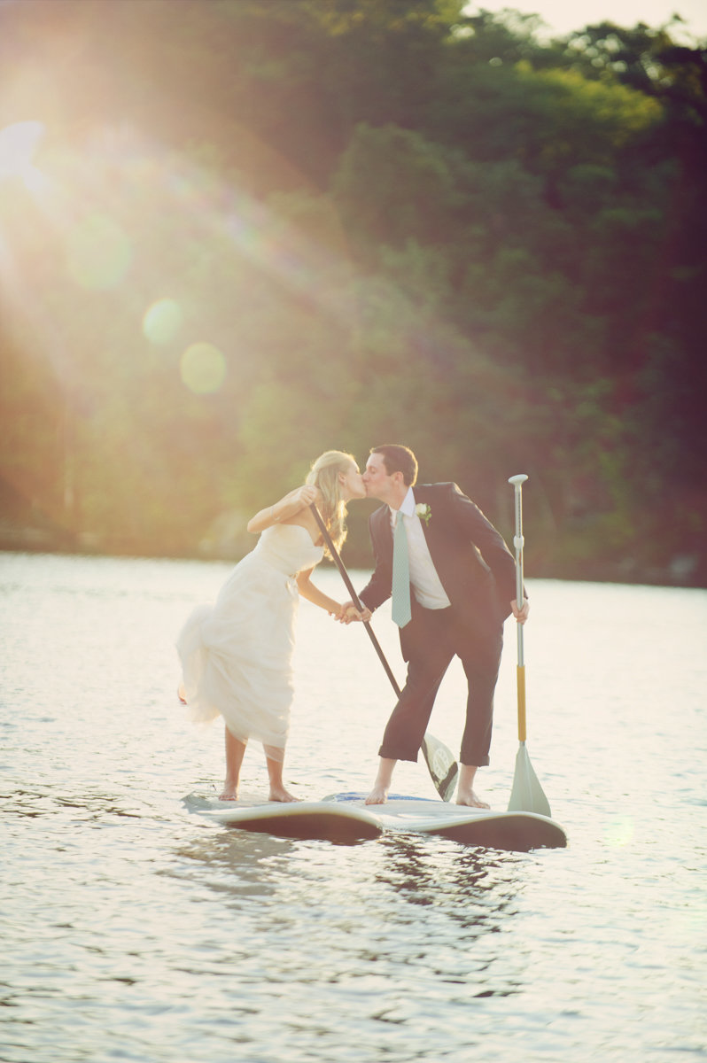 natural adventurous couple wanderlust paddle board unique wedding day kiss lake jersey shore beach golden hour