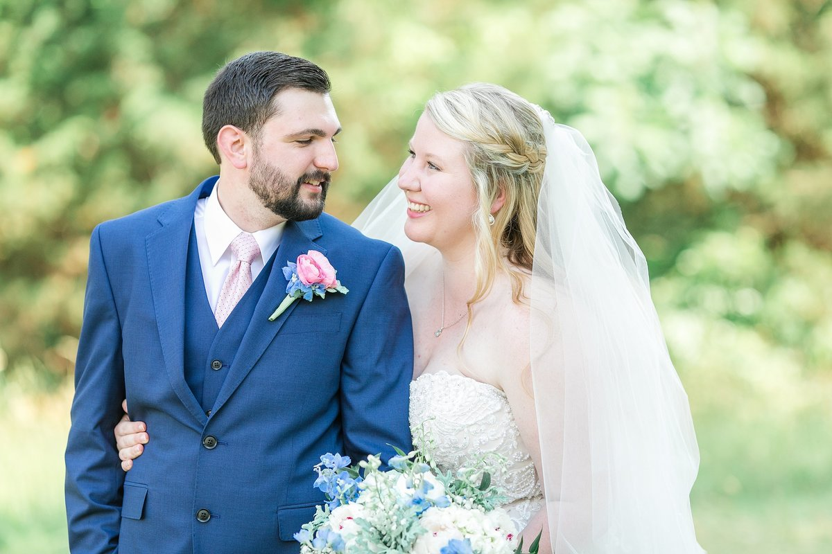 bride-groom-smiling-blush-navy