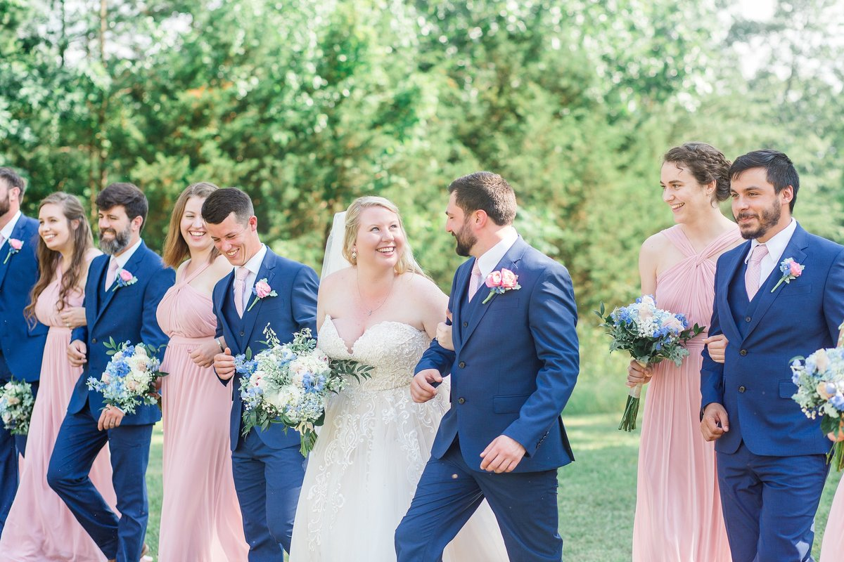 joyful-bridal-party-walking-blush-navy-peonies