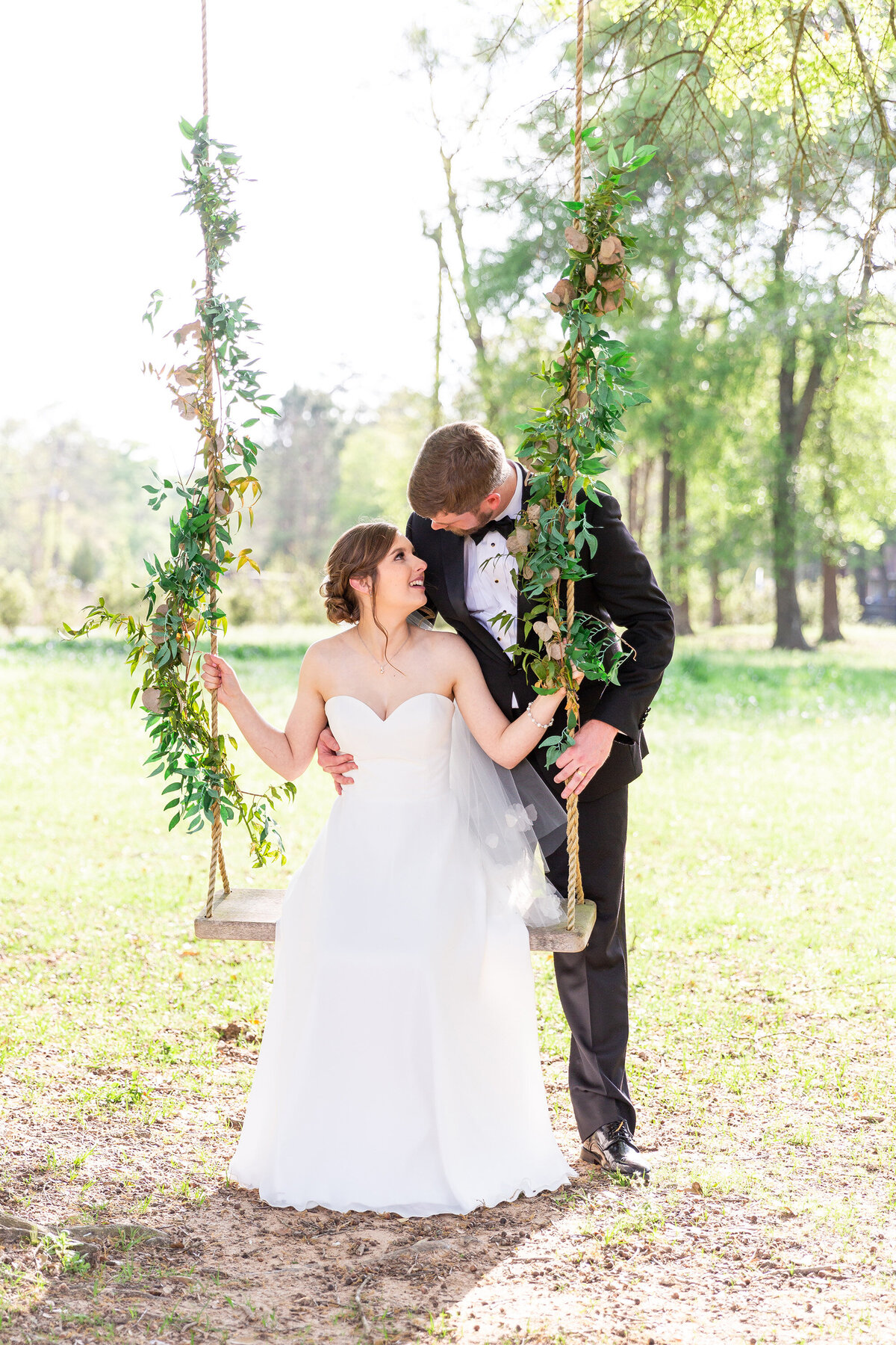 Sweet Moment Between Bride and Groom on a Swing