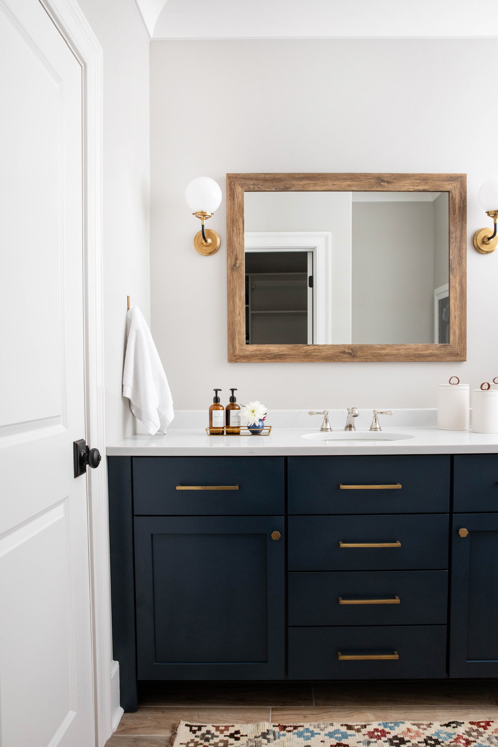 Benjamin-Moore-Blue-Note-Vanity-with-Brass-Hardware-and-Circa-Lighting-Sconce-1