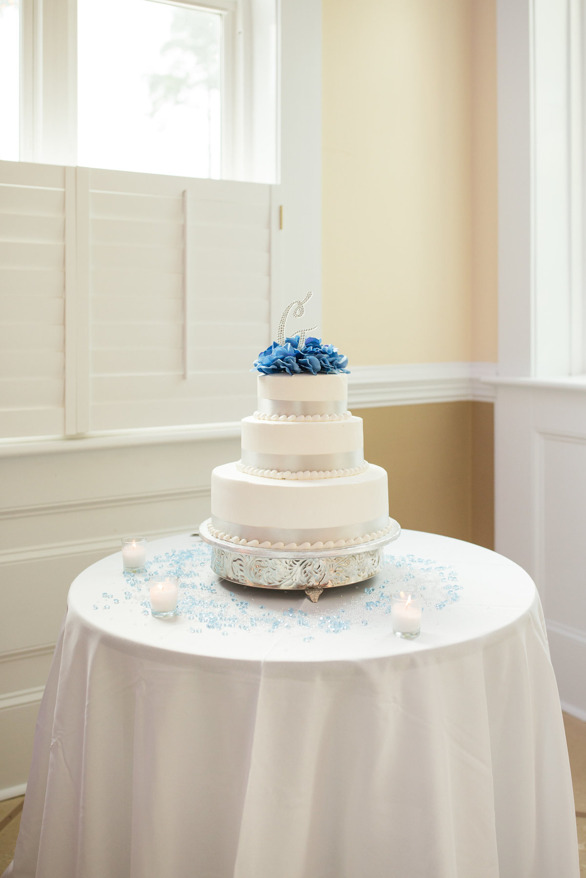 wedding cake in front of a window in savannah
