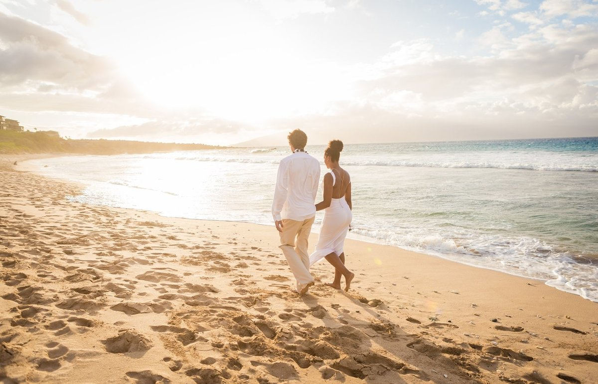 Capture Aloha Photography at The Westin Maui Resort and Spa with Groom and Bride at the beautiful beach and sunset