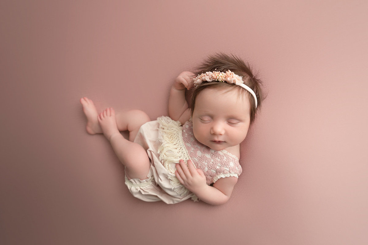 columbus-ohio-affordable-newborn-photographer-baby-girl-in-blush-and rose-pink-natural-posing-amanda-estep-photography