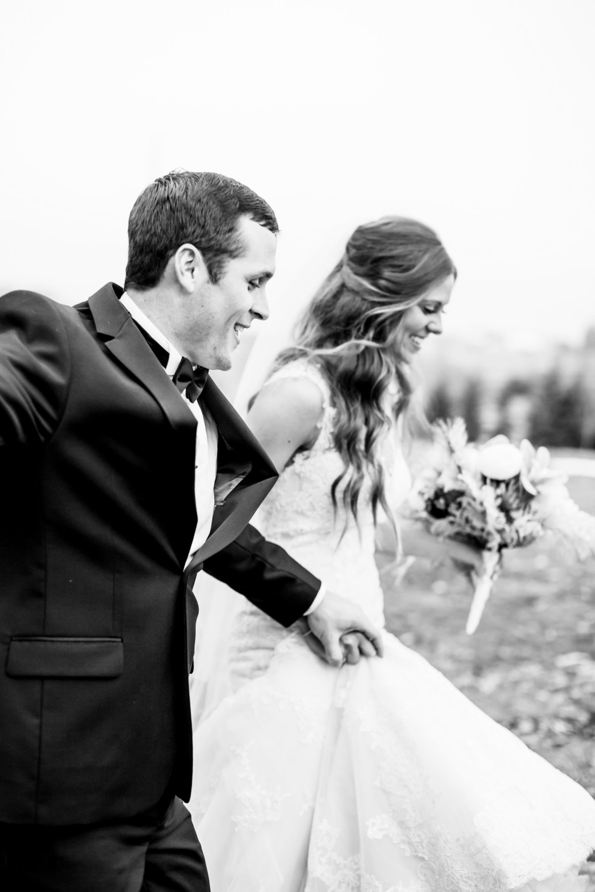 Bride and Groom Running on Wedding Day