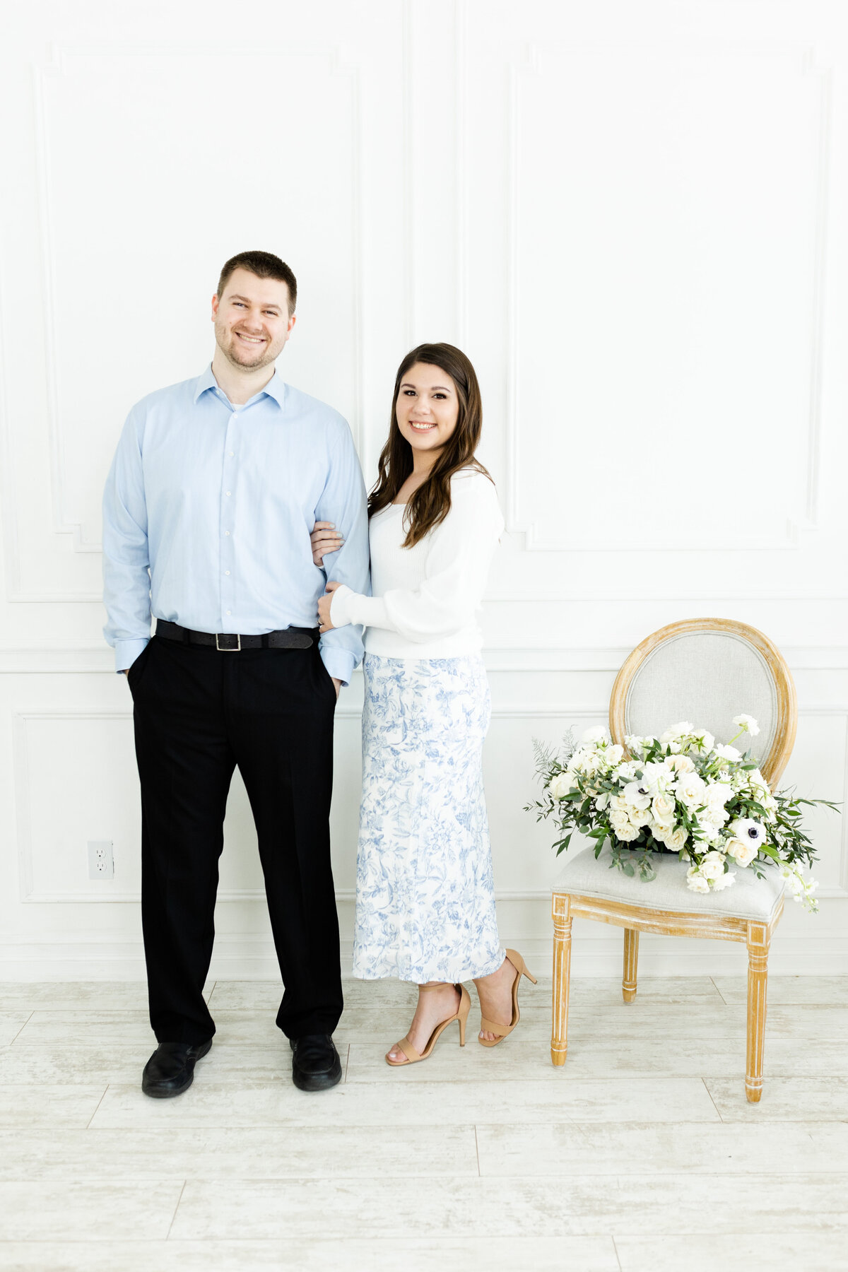 wedding photographers posing with flowers for brand