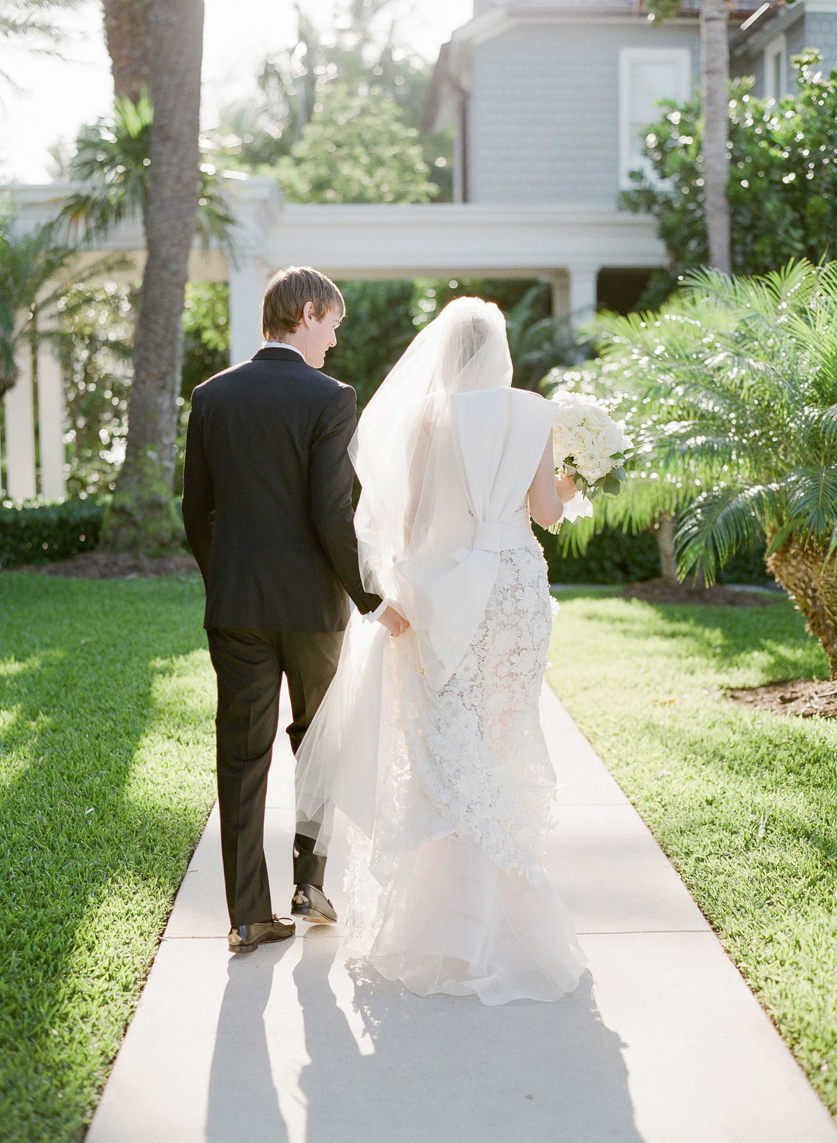 26-KTMerry-weddings-bride-groom-leaving-church-Palm-Beach