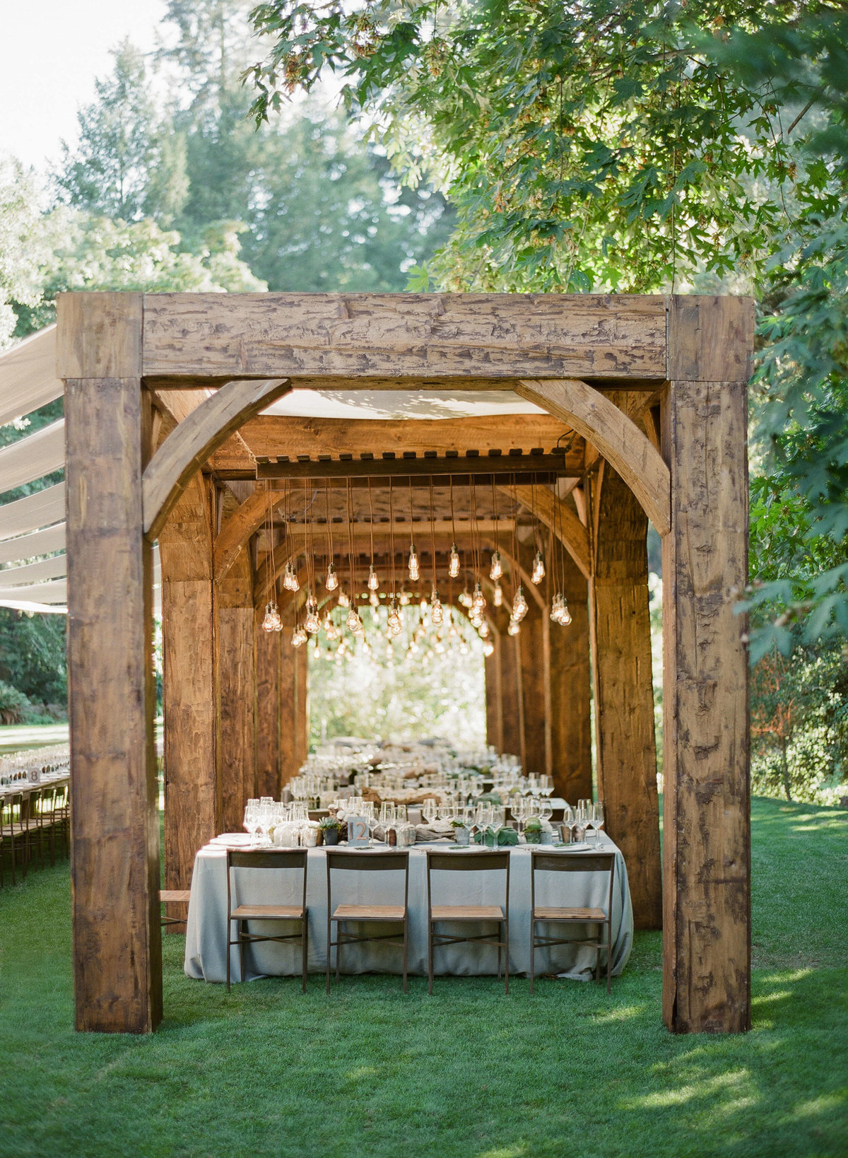54-KTMerry-wedding-reception-wooden-arbor-NapaValley